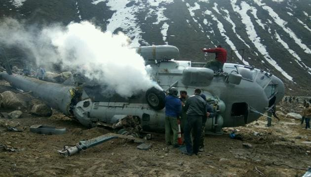 The personnel of Nehru Institute of Mountaineering and local police swung into action soon after the Russian-origin transport helicopter crashed above the helipad located behind the Kedarnath shrine on Tuesday.(NIM)