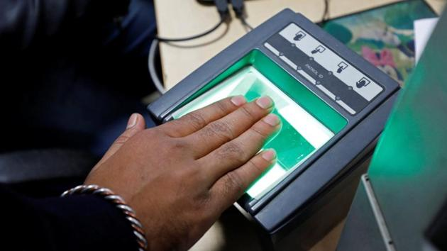 A woman goes through the process of finger scanning for the Unique Identification (UID) database system, also known as Aadhaar, at a registration centre in New Delhi.(Reuters File Photo)