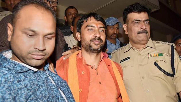 Union minister of state Ashwini Kumar Choubey's son and RSS leader Arijit Shashwat is taken away after he was arrested by the police near Mahavir Temple for allegedly triggering communal violence, in Patna on April 1, 2018.(PTI Photo)