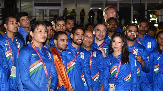 Indian contingent with officials during the country's flag-hoisting ceremony at the Commonwealth Games 2018 in Gold Coast, Australia, on Monday.(PTI)
