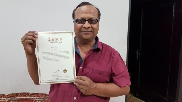 Pramod Kumar Aggarwal with the certificate issued by the office of Limca Book of Records.(HT Photo)