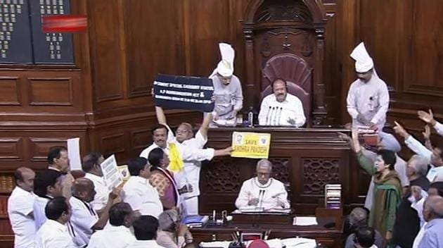 Opposition members protest during the ongoing budget session of Rajya Sabha, at Parliament House in New Delhi.(PTI Photo/TV Grab)