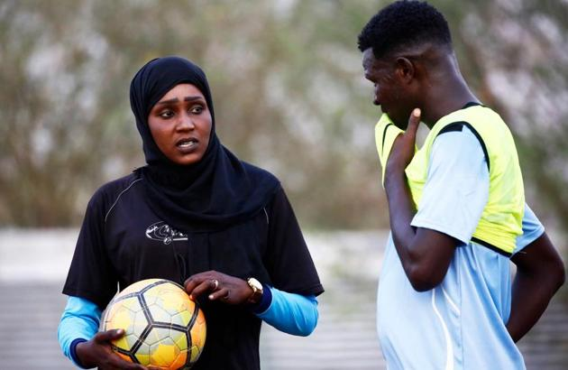 Salma al-Majidi, acknowledged by FIFA as the first Arab and Sudanese woman to coach a men's football team in the Arab world, coaches players of the Al-Ahly Al-Gadaref club during a training session in the town of Gedaref, east of Khartoum on February 17, 2018.(AFP)