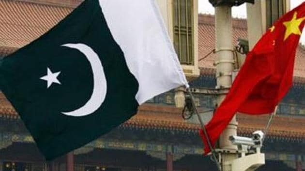 A Pakistan national flag flies alongside a Chinese national flag in Beijing's Tiananmen Square.(REUTERS)