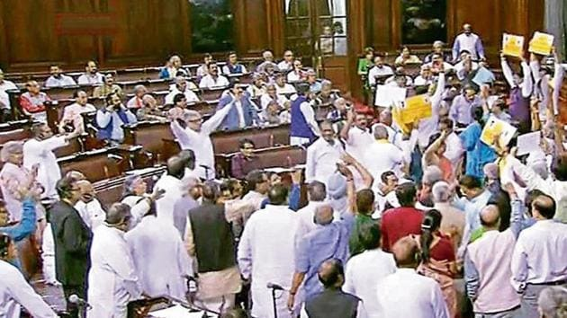 Opposition members protest in the well of the Rajya Sabha on Wednesday.(PTI File Photo)