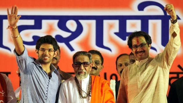 Aaditya Thackeray with late Bal Thackrey and Shiv Sena chief Uddhav Thackeray.(HT File)