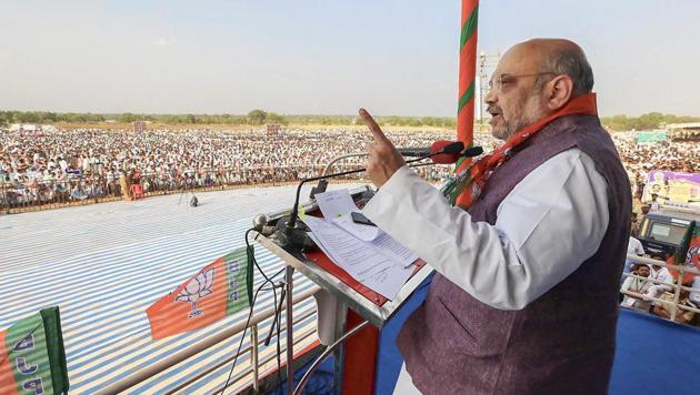 BJP president Amit Shah, who launched a two-day tour of Odisha on Wednesday, said at a public meeting in Kalahandi district that nobody has the audacity to change the provisions for reservation in the Constitution written by Babasaheb Ambedkar.(PTI File)