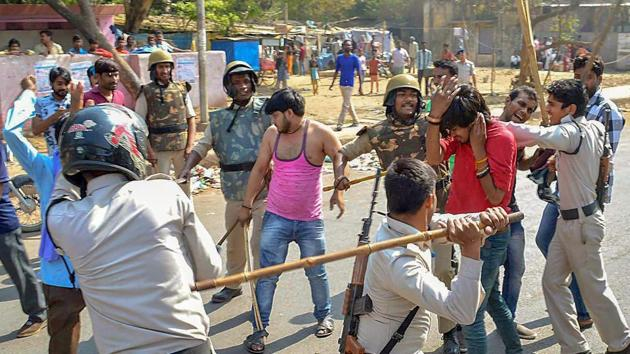 Police personnel lathi charge a protestor during 'Bharat Bandh' against the alleged 'dilution' of Scheduled Castes/Scheduled Tribes act, in Gwalior on April 2, 2018.(PTI Photo)