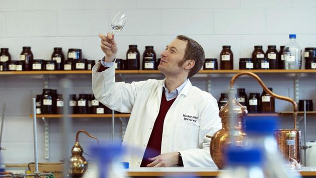 Assistant professor of distilling, Matthew Pauley, at the International Centre for Brewing and Distilling, Heriot-Watt University in Edinburgh, Scotland.(AFP PHOTO / ANDY BUCHANAN)
