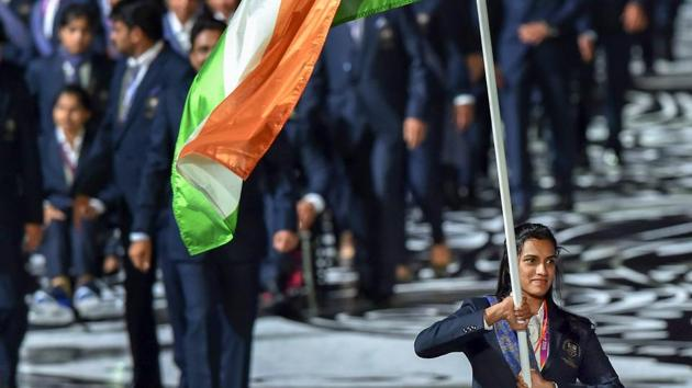 Flagbearer PV Sindhu leads the Indian contingent at Carrara Stadium during the opening ceremony of 2018 Commonwealth Games in Gold Coast, Australia, on Wednesday.(PTI)