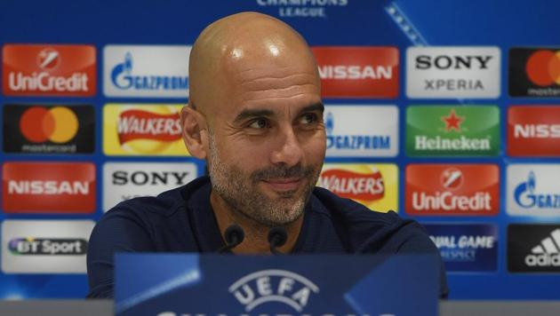 Manchester City's Spanish manager Pep Guardiola attends a press conference on the eve of the UEFA Champions League first leg quarter-final football match against Liverpool, at Anfield stadium in Liverpool, north west England on April 3, 2018.(AFP)