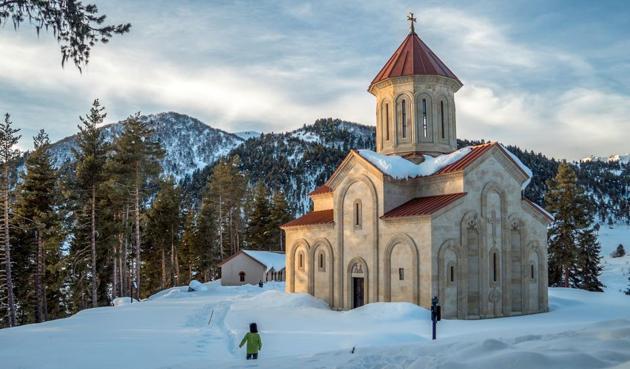 A man walking past a church in Samegrelo-Zemi Svaneti.(AFP)