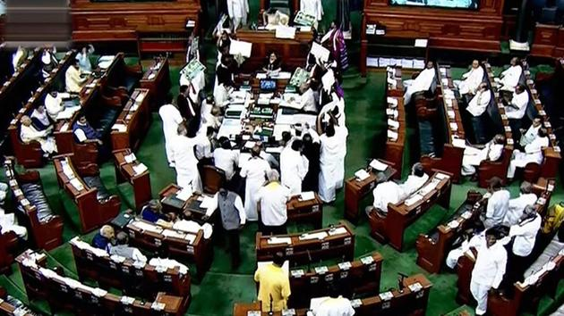 Opposition members protest during the ongoing budget session of Parliament in Lok Sabha in New Delhi on Wednesday.(PTI Photo)