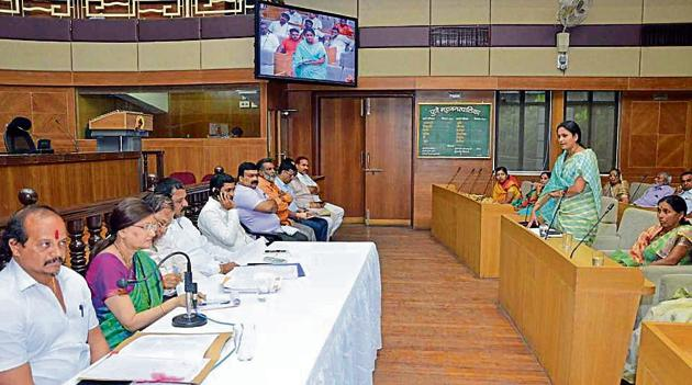 Mayor Mukta Tilak leads the panel of gram panchayat and PMC officials taking questions from the representatives of 11 villages merged within PMC limits.(HT PHOTO)