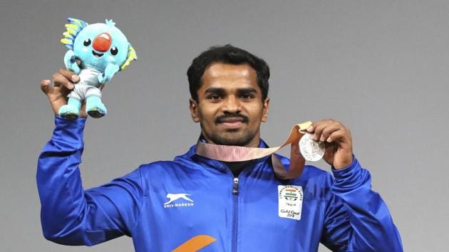 India's P Gururaja celebrates after receiving his silver medal in the Men's 56kg weightlifting event at the 2018 Commonwealth Games in Gold Coast, Australia, on Thursday.(AP)