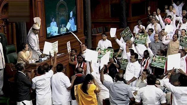 AIADMK members protest in the well of Lok Sabha in New Delhi on Thursday.(PTI Photo)