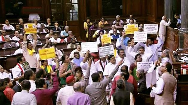 Opposition members protest in the well of the Rajya Sabha during the budget session.(PTI FILE Photo / TV GRAB)