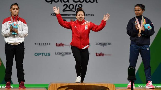 Gold medallist Indian weightlifter Mirabai Chanu during the medal ceremony of women's 48kg event during the 2018 Commonwealth Games in Gold Coast on Thursday.(PTI)