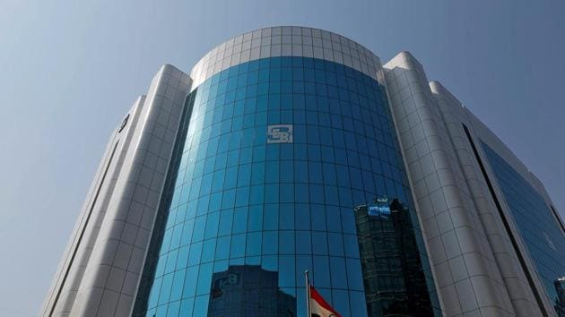The logo of the Securities and Exchange Board of India (SEBI) is seen on the facade of its headquarters building in Mumbai, India.(REUTERS File Photo)
