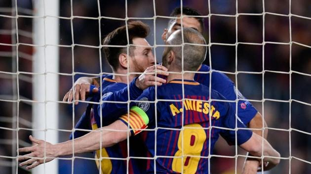 (L-R) FC Barcelona's Lionel Messi, Luis Suarez and Andres Iniesta celebrate after AS Roma scored an own goal during their UEFA Champions League quarterfinal first leg football match at the Camp Nou Stadium in Barcelona on Wednesday.(AFP)