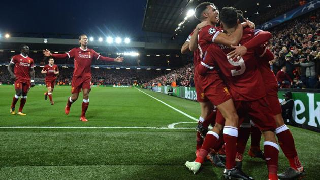 Liverpool celebrate their second goal during the UEFA Champions League first leg quarter-final vs Manchester City at Anfield stadium in Liverpool on April 4, 2018.(AFP)