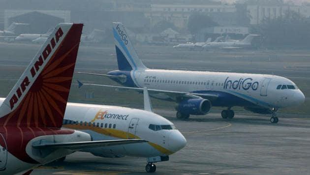 An IndiGo Airlines' A320 aircraft and and Air India Airbus A321 aircraft at Mumbai's Chhatrapathi Shivaji International Airport.(Reuters File Photo)