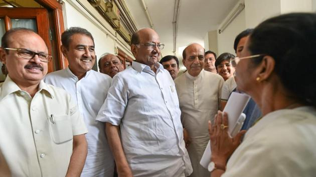 Mamata Banerjee (right, pictured with NCP's Sharad Pawar) has announced that she will dissociate herself from the rural polls and focus to drum up support of regional parties to form an anti-BJP front for the Lok Sabha elections next year.(PTI/File Photo)