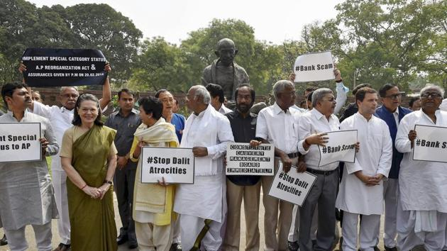 Opposition members protest in Parliament during the budget session in New Delhi on Thursday.(PTI Photo)
