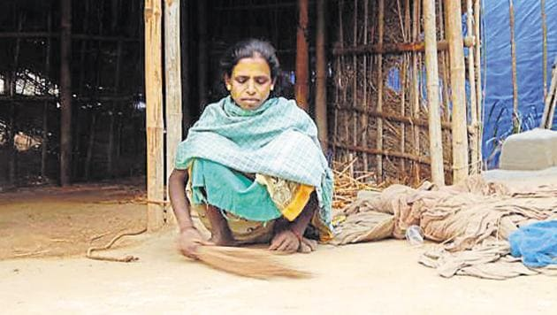 Tara May Devi, whose husband died after being released from jail, sits outside her hut in Purnia's Kathol village. She sold her cattle to make ends meet.(Vishal Chandra/HT Photo)