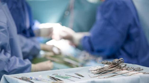 sterile surgical instruments on during the operation table amid the surgeons(Getty Images/iStockphoto)