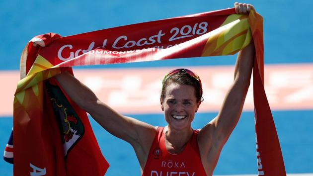 Bermuda's Flora Duffy celebrates on the finish line after winning the women's triathlon in the 2018 Commonwealth Games at the Southport Broadwater Parklands venue in the Gold Coast on Thursday.(AFP)