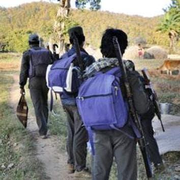 CPI Maoists platoon crossing a field in Jharkhand-Chhatisgarh border.(HT Photo)