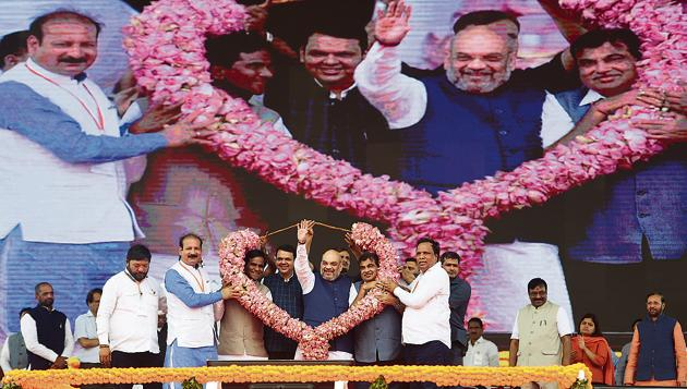 BJP leaders with party president Amit Shah at the rally at BKC on Friday.(Satyabrata Tripathy/HT Photo)
