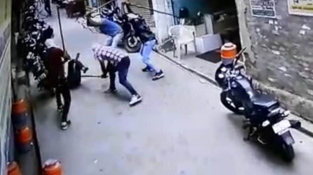 A video grab showing men with masked faces beating up victim Sunil Kumar in Jind on Thursday.(HT Photo)
