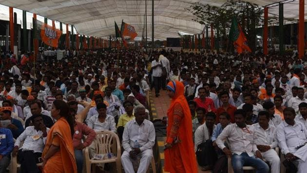 BJP workers at Bandra-Kurla Complex in Mumbai on Friday. Party leaders said an estimated three lakh workers from across Maharashtra will attend the rally.(Satish Bate/HT Photo)