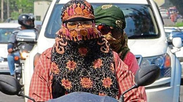 Punjab and Haryana exempt only Sikh women from wearing helmets while Chandigarh exempts all women.(HT File)
