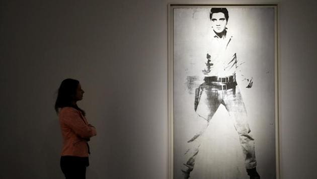 A painting by Andy Warhol called 'Double Elvis [Ferus Type]' (1963) is displayed at Christie's auction rooms in London.(AP)