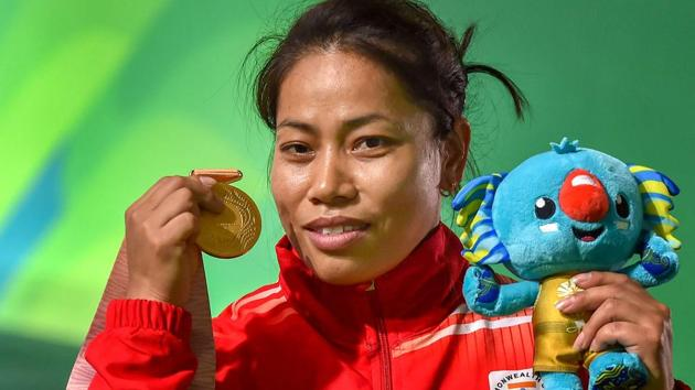 Sanjita Chanu poses with her gold medal after winning the women's 53kg weightlifting event at the 2018 Commonwealth Games in Gold Coast on Friday.(PTI)