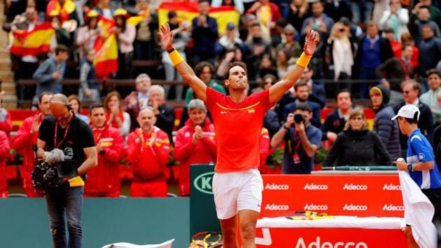 Rafael Nadal on Friday won his first match since limping out of the Australian Open in January when he beat Germanys Philipp Kohlschreiber in straight sets in the Davis Cup quarter-finals.(REUTERS)
