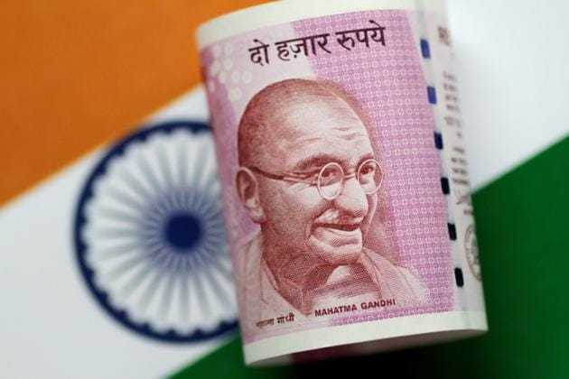 So far this year, the rupee fell 1.76%, while foreign investors have bought $2.10 billion and $400 million in equity and debt markets respectively.(Reuters File Photo)