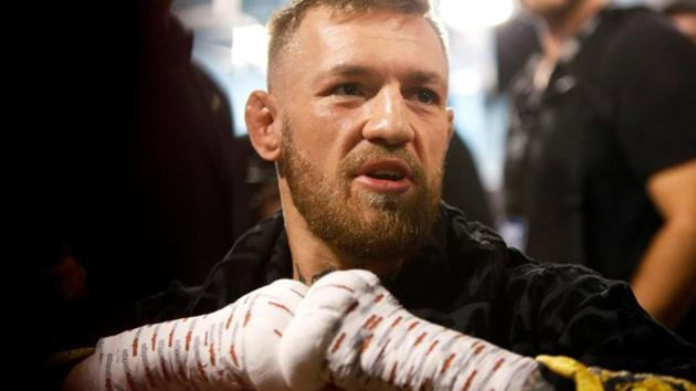 As the UFC held a media day on Thursday ahead of the upcoming fight card at the Barclays Center in Brooklyn on Saturday, Conor McGregor and his entourage entered through a side entrance and attacked a van containing other fighters.(Reuters)