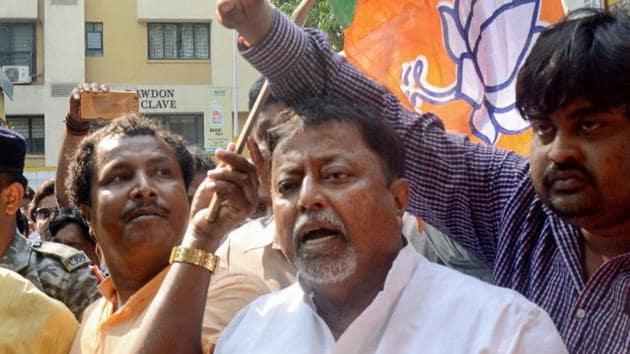 BJP leader Mukul Roy and others sits in a demonstration to protest against the violence during Panchayat polls' nomination filing, in Kolkata on Wednesday.(PTI)