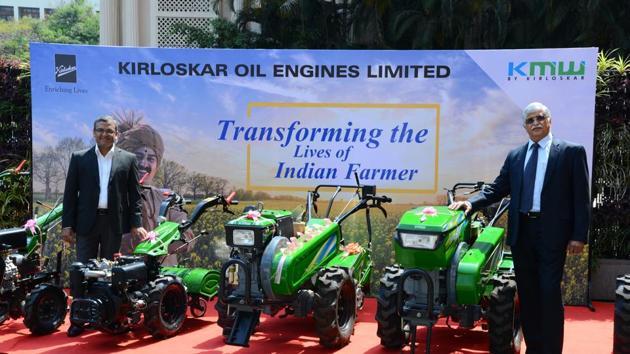 Antony Cherukara (left) and RR Deshpande displaying the KMW27s range of farm mechanisation products from Kirloskar Oil Engines Ltd.(HT PHOTO)