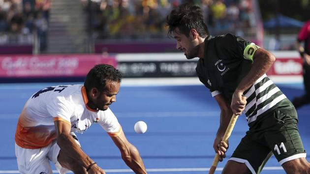 India's Lalit Kumar Upadhyay, left, and Pakistan's Muhammad Rizwan compete for the ball during their match at the Hockey Center during the 2018 Commonwealth Games on the Gold Coast, Australia, Saturday.(AP)