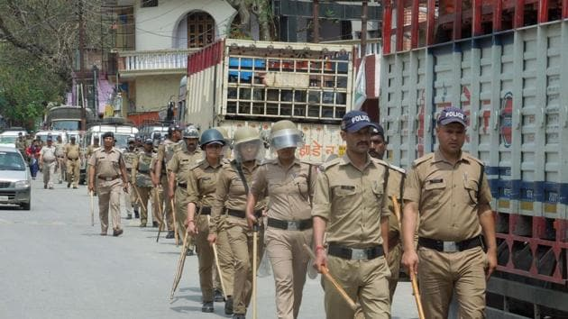 Police took out flag march in Augustmuni on Saturday after Section 144 of CrPC was enforced on Friday night.(HT Photo)