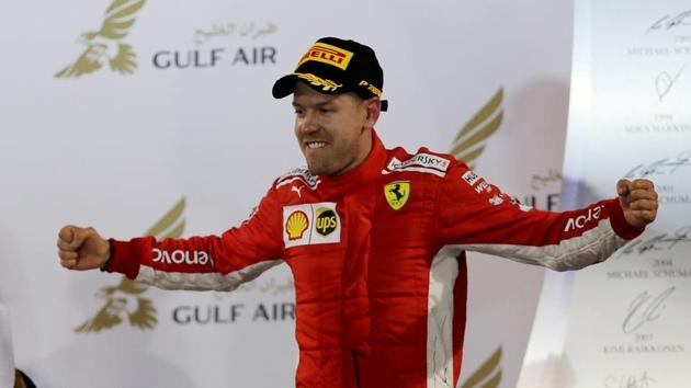 Ferrari's Sebastian Vettel celebrates on the podium after winning the Bahrain Grand Prix on Sunday.(REUTERS)