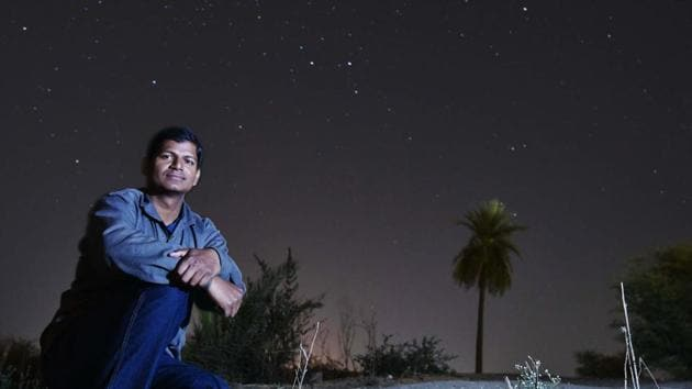 Pradeepta Mohanty, 30, an engineer from Madhya Pradesh, scans footage of space on his laptop and marks objects that could indicate unique galaxies.(Mujeeb Faruqui / HT Photo)
