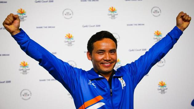 Jitu Rai celebrates after winning the gold medal in the men's 10m air pistol shooting event at the 2018 Commonwealth Games (CWG 2018) at the Belmont Shooting Complex in Gold Coast on Monday.(AFP)