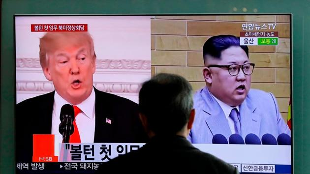 In this March 27, 2018, a man watches a TV screen showing file footages of US President Donald Trump, left, and North Korean leader Kim Jong Un during a news programme at the Seoul Railway Station in Seoul, South Korea.(AP File Photo)