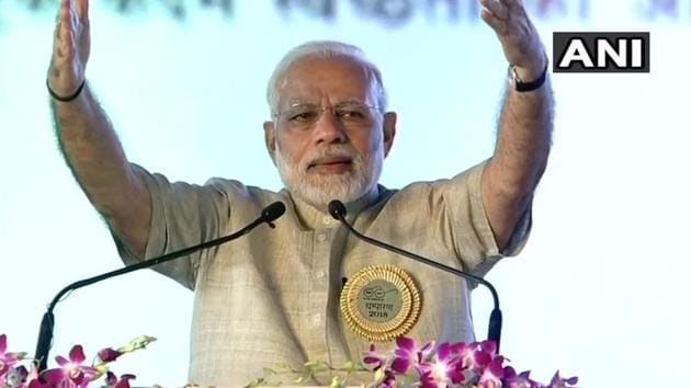 Prime Minister Narendra Modi addresses people after inaugurating a loco factory in Motihari on Tuesday.(ANI/Twitter)